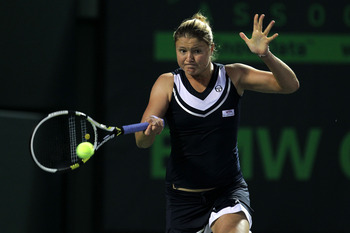 KEY BISCAYNE, FL - MARCH 23:  Dinara Safina of Russia returns against Jelena Dokic of Australia during the Sony Ericsson Open at Crandon Park Tennis Center on March 23, 2011 in Key Biscayne, Florida.  (Photo by Al Bello/Getty Images)