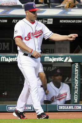 CLEVELAND, OH - JUNE 3: Manny Acta #11 of the Cleveland Indians calls to the bullpen to replace starting pitcher Justin Masterson #63 (not shown) during the sixth inning against the Texas Rangers at Progressive Field on June 3, 2011 in Cleveland, Ohio.  (