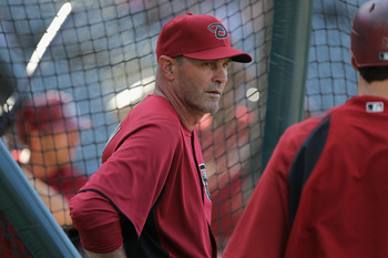 DENVER, CO - APRIL 02:  Manager Kirk Gibson #23 of the Arizona Diamondbacks watches his team as they take batting practice prior to facing the Colorado Rockies at Coors Field on April 2, 2011 in Denver, Colorado. The Rockies defeated the Diamondbacks 3-1.