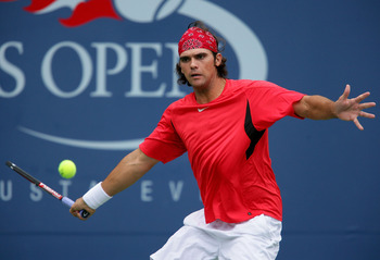 NEW YORK - AUGUST 30:  Mark Philippoussis of Australia returns a shot during his match against Rafael Nadal of Spain during the U.S. Open at the USTA Billie Jean King National Tennis Center in Flushing Meadows Corona Park on August 30, 2006 in the Flushin