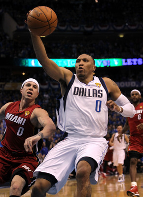 DALLAS, TX - JUNE 05:  Shawn Marion #0 of the Dallas Mavericks reaches for a ball against Mike Bibby #0 of the Miami Heat in Game Three of the 2011 NBA Finals at American Airlines Center on June 5, 2011 in Dallas, Texas.  NOTE TO USER: User expressly ackn