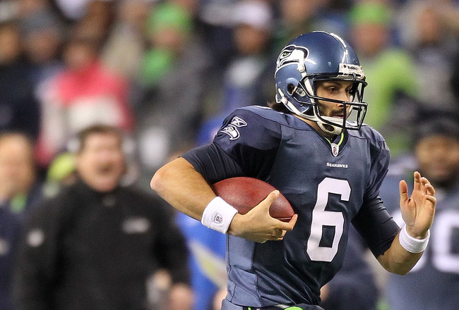 SEATTLE, WA - JANUARY 02:  Quarterback Charlie Whitehurst #6 of the Seattle Seahawks runs with the ball during their game against the St. Louis Rams at Qwest Field on January 2, 2011 in Seattle, Washington.  (Photo by Otto Greule Jr/Getty Images)