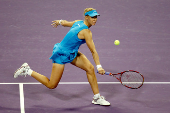 DOHA, QATAR - OCTOBER 28:  Elena Dementieva of Russia returns a shot to Samantha Stosur of Australia during day three of the WTA Championships at the Khalifa Tennis Complex on October 28, 2010 in Doha, Qatar.  (Photo by Matthew Stockman/Getty Images)