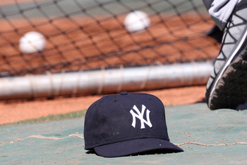 BOSTON, MA - APRIL 9:  The cap of Jorge Posada #20 of the New York Yankees rests on the ground during batting practice before a game against the Boston Red Sox at Fenway Park April 9, 2011 in Boston, Massachusetts. (Photo by Jim Rogash/Getty Images)