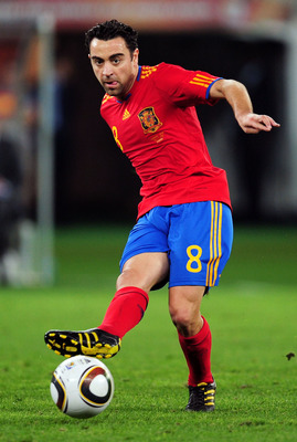 DURBAN, SOUTH AFRICA - JULY 07:  Xavi Hernandez of Spain passes the ball during the 2010 FIFA World Cup South Africa Semi Final match between Germany and Spain at Durban Stadium on July 7, 2010 in Durban, South Africa.  (Photo by Clive Mason/Getty Images)