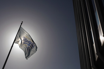 KANSAS CITY, MO - JULY 19:  A Kansas City Royals flag flies outside of Kauffman Stadium during the game between the Toronto Blue Jays and the Kansas City Royals on July 19, 2010 at Kauffman Stadium in Kansas City, Missouri.  (Photo by Jamie Squire/Getty I