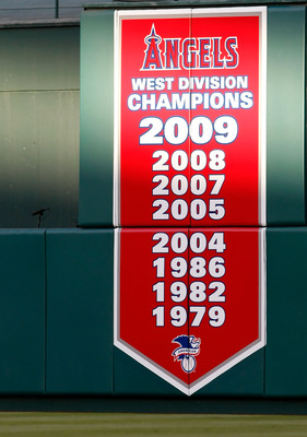 ANAHEIM, CA - OCTOBER 01:  A banner in center field announces the 2009 West Division Champion Los Angeles Angels of Anaheim during the game against the Texas Rangers at Angel Stadium on October 1, 2009 in Anaheim, California. The Rangers defeated the Ange
