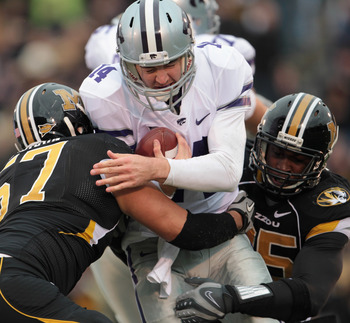 COLUMBIA, MO - NOVEMBER 13:  Quarterback Carson Coffman #14 of the Kansas State Wildcats is sacked by Brad Madison #57 and Aldon Smith #85 of the Missouri Tigers during the game on November 13, 2010 at Faurot Field/Memorial Stadium in Columbia, Missouri.