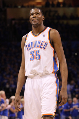 OKLAHOMA CITY, OK - MAY 23:  Kevin Durant #35 of the Oklahoma City Thunder smiles in the first quarter while taking on the Dallas Mavericks in Game Four of the Western Conference Finals during the 2011 NBA Playoffs at Oklahoma City Arena on May 23, 2011 i