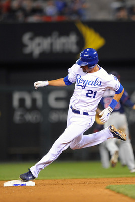 KANSAS CITY, MO - JUNE 2: Jeff Francoeur #21 of the Kansas City Royals steps on second base on his way to a triple against the Minnesota Twins at Kauffman Stadium on June 2, 2011 in Kansas City, Missouri. The Twins defeated the Royals 8-2. (Photo by G. Ne