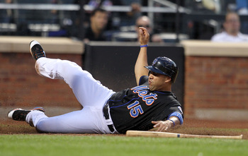 NEW YORK, NY - JUNE 03:  Carlos Beltran #15 of the New York Mets slides into home against the Atlanta Braves at Citi Field on June 3, 2011 in the Flushing neighborhood of the Queens borough of New York City.  (Photo by Nick Laham/Getty Images)