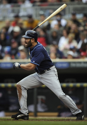 MINNEAPOLIS, MN - APRIL 28: Johnny Damon #22 of the Tampa Bay Rays singles against the Minnesota Twins in the second inning of their game on April 28, 2011 at Target Field in Minneapolis, Minnesota. The Rays defeated the Twins 15-3. (Photo by Hannah Fosli