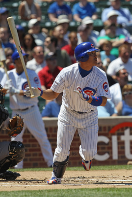 CHICAGO, IL - JUNE 01:  Kosuke Fukudome #1 of the Chicago Cubs hits a solo home run in the 1st inning against the Houston Astros at Wrigley Field on June 1, 2011 in Chicago, Illinois.  The Astros defeated the Cubs 3-1. (Photo by Jonathan Daniel/Getty Imag
