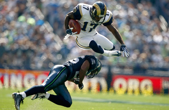 SEATTLE , WA - SEPTEMBER 13:  Donnie Avery #17 of the St. Louis Rams leaps over Josh Wilson #26 of the Seattle Seahawks at Qwest Field on September 13, 2009 in Seattle, Washington.  (Photo by Jonathan Ferrey/Getty Images)