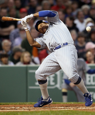 BOSTON, MA - MAY 21:  Marlon Byrd #24 of the Chicago Cubs is hits a in the head by a pitch in the second inning against the Boston Red Sox  on May 21, 2011 at Fenway Park in Boston, Massachusetts. Tonight the Chicago Cubs and the Boston Red Sox are wearin
