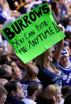 VANCOUVER, BC - JUNE 04:  A fan of the Vancouver Canucks holds a sign up that reads 'Burrows You Can Bite Me Anytime!!' during Game Two against the Boston Bruins in the 2011 NHL Stanley Cup Final at Rogers Arena on June 4, 2011 in Vancouver, British Colum