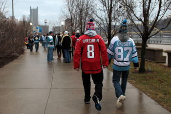 PITTSBURGH, PA - JANUARY 01:  A fan of the Washington Captials wears an 'Ovechkin' jersey while walking alongside a fan of the Pittsburgh Penguins wearing a 'Crosby' jersey prior to the start of the 2011 NHL Bridgestone Winter Classic at Heinz Field on Ja