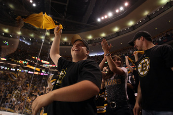 BOSTON, MA - JUNE 08:  Boston Bruins fans cheer during Game Four against the Vancouver Canucks in the 2011 NHL Stanley Cup Final at TD Garden on June 8, 2011 in Boston, Massachusetts.  (Photo by Elsa/Getty Images)