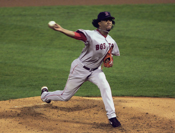 ST. LOUIS - OCTOBER 26:  Pedro Martinez #45 of the Boston Red Sox pitches against the St. Louis Cardinals during game three of the 2004 World Series on October 26, 2004 at Busch Stadium in St. Louis, Missouri. The Boston Red Sox defeated the St. Louis Car