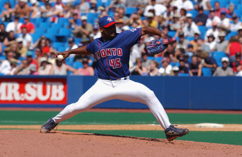 TORONTO - JULY 14 :  Winning pitcher Kelvim Escobar #45 of the Toronto Blue Jays throws the ball against the Boston Red Sox during the game on July 14, 2002 at the Skydome in Toronto, Canada.  The Blue Jays edged the Red Sox 6-5.  (Photo by Dave Sandford/
