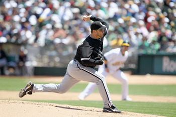 OAKLAND, CA - MAY 15:  Mark Buehrle #56 of the Chicago White Sox pitches against the Oakland Athletics at Oakland-Alameda County Coliseum on May 15, 2011 in Oakland, California.  (Photo by Ezra Shaw/Getty Images)