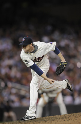 MINNEAPOLIS, MN - MAY 23: Joe Nathan #36 of the Minnesota Twins pitches against the Seattle Mariners during their game on May 23, 2011 at Target Field in Minneapolis, Minnesota. The Rockies won 6-5. (Photo by Hannah Foslien/Getty Images)