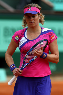 PARIS, FRANCE - MAY 26:  Kim Clijsters of Belgium gathers her thoughts during the women's singles round two match between Arantxa Rus of Netherlands and Kim Clijsters of Belgium on day five of the French Open at Roland Garros on May 26, 2011 in Paris, Fra