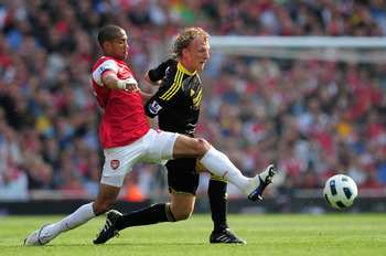 LONDON, ENGLAND - APRIL 17:  Gael Clichy of Arsenal tackles Dirk Kuyt of Liverpool during the Barclays Premier League match between Arsenal and Liverpool at the Emirates Stadium on April 17, 2011 in London, England.  (Photo by Shaun Botterill/Getty Images