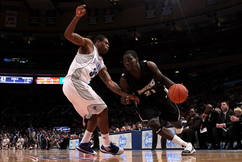 NEW YORK - MARCH 09:  Jamine Peterson #21 of the Providence Friars drives to the hoop against Jeff Robinson #32 of the Seton Hall Pirates during the first round game of the Big East Basketball Tournament at Madison Square Garden on March 9, 2010 in New Yo
