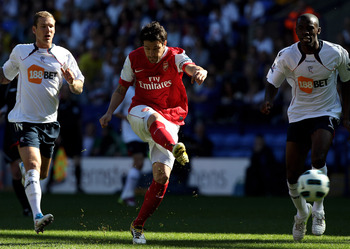 BOLTON, ENGLAND - APRIL 24:   Cesc Fabregas of Arsenal shoots at goal during the Barclays Premier League match between Bolton Wanderers and Arsenal at the Reebok Stadium on April 24, 2011 in Bolton, England. (Photo by Michael Steele/Getty Images)