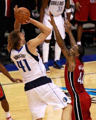 DALLAS, TX - JUNE 05:  Dirk Nowitzki #41 of the Dallas Mavericks misses a last-second shot attempt over Udonis Haslem #40 of the Miami Heat as the Mavericks were defeated 88-86 in Game Three of the 2011 NBA Finals at American Airlines Center on June 5, 20