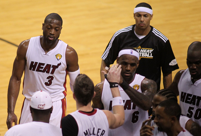 MIAMI, FL - MAY 31:  (L-R) Dwyane Wade #3 and LeBron James #6 of the Miami Heat come to the bench in the first quarter while taking on the Dallas Mavericks in Game One of the 2011 NBA Finals at American Airlines Arena on May 31, 2011 in Miami, Florida. NO