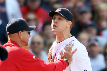 BOSTON, MA - JUNE 04:  Jonathan Papelbon #58 of the Boston Red Sox is held back by manager Terry Francona #47 in the ninth inning against the Oakland Athletics on June 4, 2011 at Fenway Park in Boston, Massachusetts.  (Photo by Elsa/Getty Images)