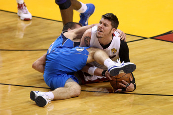 MIAMI, FL - JUNE 02:  Mike Miller #13 of the Miami Heat and Jose Juan Barea #11 of the Dallas Mavericks fight for control of a loose ball in Game Two of the 2011 NBA Finals at American Airlines Arena on June 2, 2011 in Miami, Florida. NOTE TO USER: User e