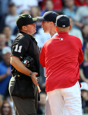 BOSTON, MA - JUNE 04:  Jonathan Papelbon #58 of the Boston Red Sox and home plate umpire Tony Randazzo #11 are separated by manager Terry Francona #47 of the Red Sox in the bottom of the ninth inning against the Oakland Athletics on June 4, 2011 at Fenway