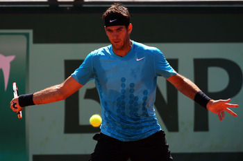PARIS, FRANCE - MAY 28:  Juan Martin Del Potro of Argentina hits a forehand during the men's singles round three match between Juan Martin Del Potro of Argentina and Novak Djokovic of Serbia on day seven of the French Open at Roland Garros on May 28, 2011