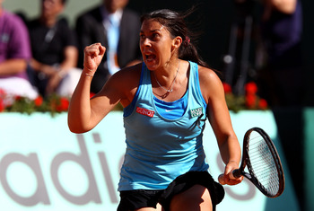 PARIS, FRANCE - JUNE 02:  Marion Bartoli of France celebrates a point during the women's singles semi final match between Marion Bartoli of France and Francesca Schiavone of Italy on day twelve of the French Open at Roland Garros on June 2, 2011 in Paris,