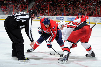 WASHINGTON - NOVEMBER 28:  Brooks Laich #21 of the Washington Capitals takes a face off against Eric Staal #12 of the Carolina Hurricanes at the Verizon Center on November 28, 2010 in Washington, DC.  (Photo by Greg Fiume/Getty Images)