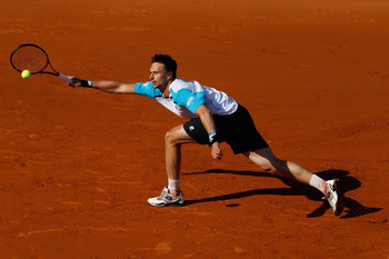 PARIS, FRANCE - JUNE 01:  Robin Soderling of Sweden hits a forehand during the men's singles quarterfinal match between Rafael Nadal of Spain and Robin Soderling of Sweden on day eleven of the French Open at Roland Garros on June 1, 2011 in Paris, France.