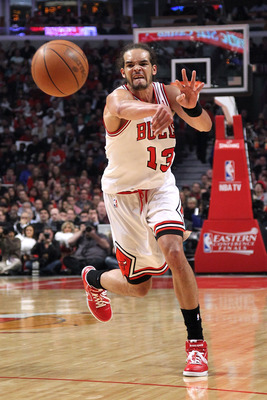 CHICAGO, IL - MAY 26:  Joakim Noah #13 of the Chicago Bulls passes the ball agains the Miami Heat in Game Five of the Eastern Conference Finals during the 2011 NBA Playoffs on May 26, 2011 at the United Center in Chicago, Illinois. NOTE TO USER: User expr