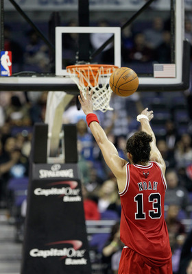 WASHINGTON, DC - FEBRUARY 28: Joakim Noah #13 of the Chicago Bulls shoots a free throw against the Washington Wizards at the Verizon Center in Washington on February 28, 2011 in Washington, DC. NOTE TO USER: User expressly acknowledges and agrees that, by