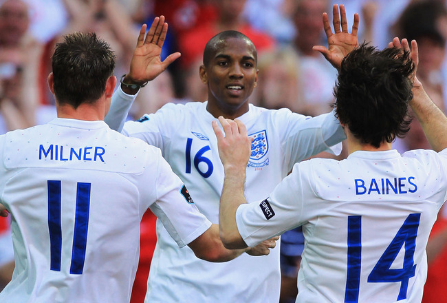 LONDON, ENGLAND - JUNE 04:  Ashley Young of England (C) celebrates scoring their second goal with teammates James Milner (L) and Leighton Baines during the UEFA EURO 2012 group G qualifying match between England and Switzerland at Wembley Stadium on June