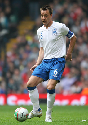 CARDIFF, WALES - MARCH 26:  John Terry of England in action during the UEFA EURO 2012 Group G qualifying match between Wales and England at the Millennium Stadium on March 26, 2011 in Cardiff, Wales.  (Photo by Alex Livesey/Getty Images)