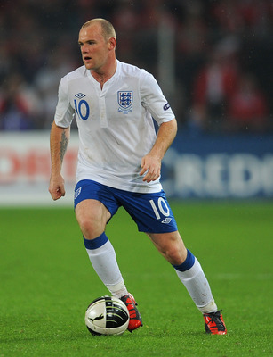 BASEL, SWITZERLAND - SEPTEMBER 07:  Wayne Rooney of England in action during the EURO 2012 Group G Qualifier between Switzerland and England at St Jakob Park on September 7, 2010 in Basel, Switzerland.  (Photo by Michael Regan/Getty Images)