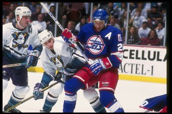 1 Dec 1993:  Bob Corkum of the Anaheim Mighty Ducks (left) and Dean Kennedy of the Winnipeg Jets fight during a game at Arrowhead Pond in Anaheim, California. Mandatory Credit: J.D. Cuban  /Allsport