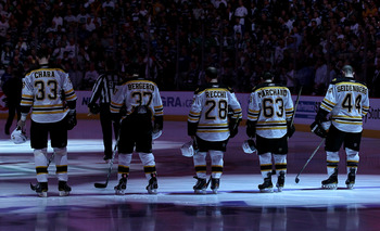 VANCOUVER, BC - JUNE 04:  (L-R) Zdeno Chara #33, Patrice Bergeron #37, Mark Recchi #28, Brad Marchand #63 and Dennis Seidenberg #44 of the Boston Bruins stand on the ice during Canada's national anthem prior to Game Two against the Vancouver Canucks in th