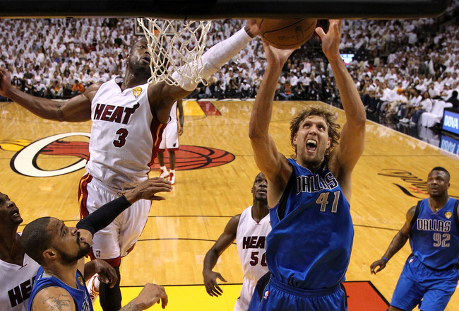 MIAMI, FL - JUNE 02:  Dirk Nowitzki #41 of the Dallas Mavericks attempts a shot against Dwyane Wade #3 of the Miami Heat in Game Two of the 2011 NBA Finals at American Airlines Arena on June 2, 2011 in Miami, Florida. NOTE TO USER: User expressly acknowle
