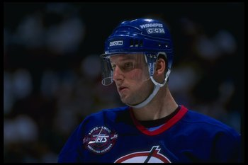 14 Apr 1996:  Center Craig Janney of the Winnipeg Jets looks on during a game against the Anaheim Mighty Ducks at Arrowhead Pond in Anaheim, California.  The Ducks won the game, 5-2. Mandatory Credit: Glenn Cratty  /Allsport