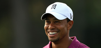 PONTE VEDRA BEACH, FL - MAY 11:  Tiger Woods smiles during a practice round prior to the start of THE PLAYERS Championship held at THE PLAYERS Stadium course at TPC Sawgrass on May 11, 2011 in Ponte Vedra Beach, Florida.  (Photo by Streeter Lecka/Getty Im