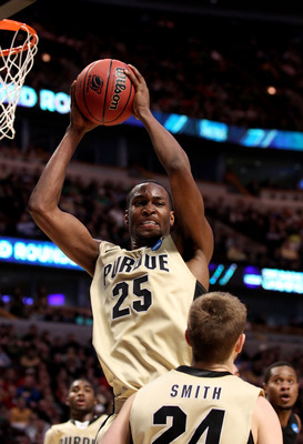 CHICAGO, IL - MARCH 20:  JaJuan Johnson #25 of the Purdue Boilermakers rebounds against the Virginia Commonwealth Rams in the second half during the third round of the 2011 NCAA men's basketball tournament at the United Center on March 20, 2011 in Chicago